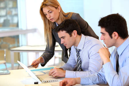 office work: Businessteam working together on project Stock Photo