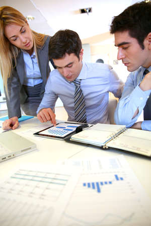 Business team working on sales results photo
