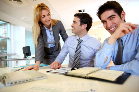 Business team working on sales results Stock Photo - 17826704