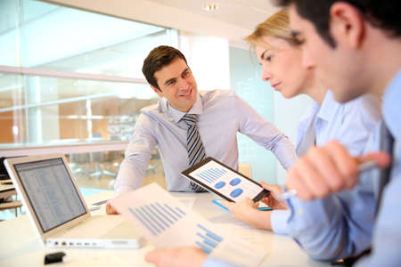 projects: Manager presenting budget to marketing people Stock Photo