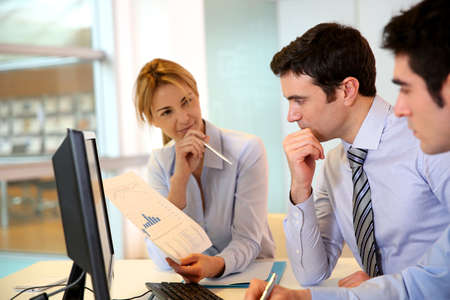 achivement: Business team working in front of desktop Stock Photo