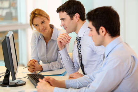 Business team working on front of desktop Stock Photo - 17826672