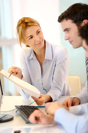 workteam: Businesswoman presenting report to workteam
