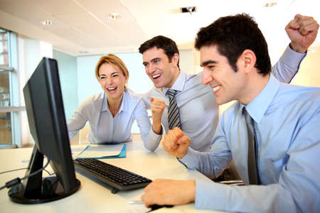 achivement: Cheerful sart-up team shouting in office Stock Photo