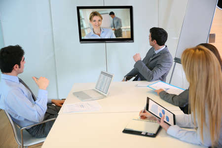 Business people attending videoconference meeting Stock Photo