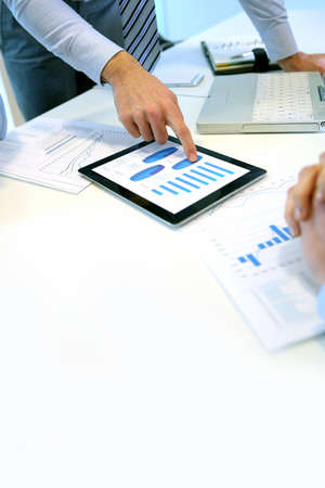 business project: Closeup of tablet screen presenting charts Stock Photo