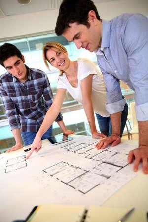 group plan: Startup business team working on blueprint