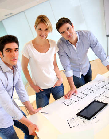 casual meeting: Group of architects working in office Stock Photo