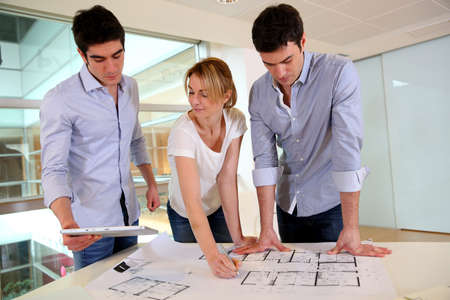 Group of architects working in office Stock Photo - 17827212