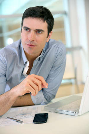 35 years old: Man giving interview to job applicant Stock Photo