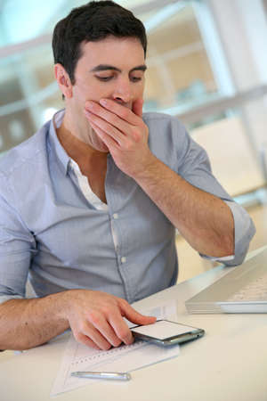 35 years old: Businessman at work getting tired
