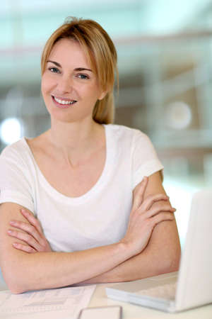 officeworker: Portrait of office-worker sitting with arms crossed Stock Photo