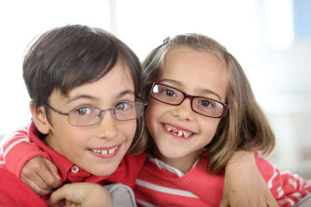 brother and sister: Portrait of kids wearing eyeglasses