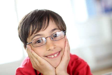 dark haired: Cute little boy wearing eyeglasses