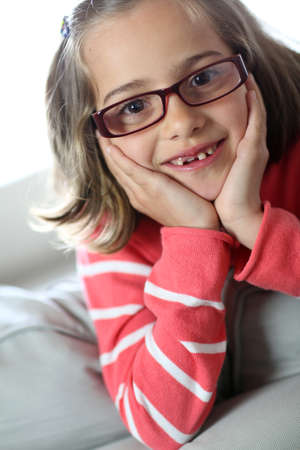 Portrait of cute little girl wearing eyeglasses photo