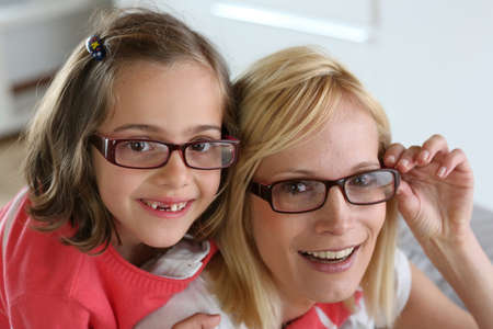 Mother and daughter with eyeglasses on photo