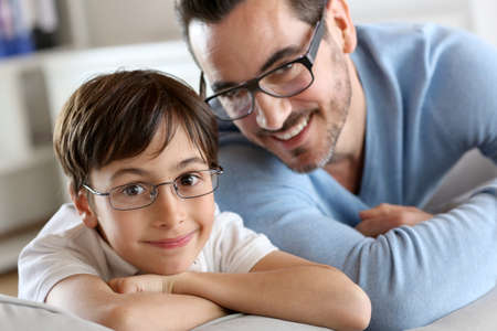 man with glasses: Portrait of young boy with daddy with eyeglasses on