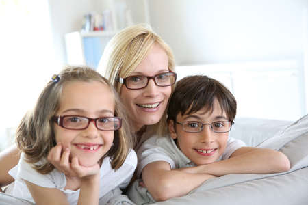 optical: Woman and children with eyeglasses on