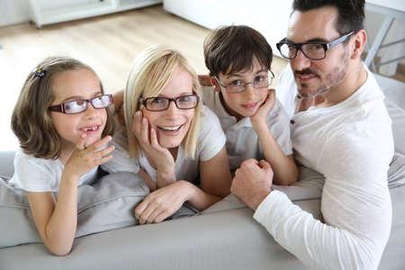 optical: Family of four wearing eyeglasses
