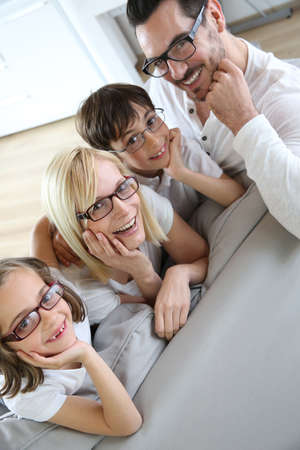 Family of four wearing eyeglasses photo