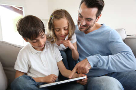 electronic tablet: Children with daddy at home using digital tablet