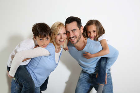 Family of four standing on white background photo