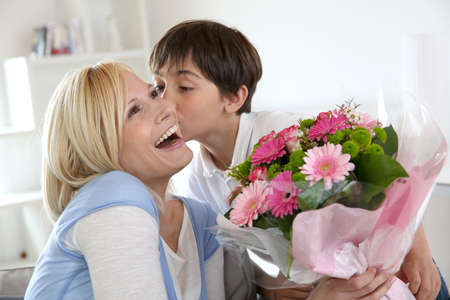 mom and dad: Young boy celebrating mothers day