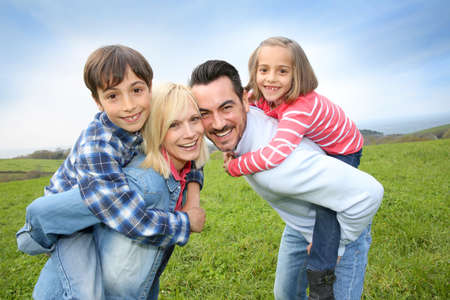 Portrait of happy family in countryside photo