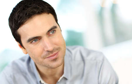 Portrait of handsome man with dark hair photo