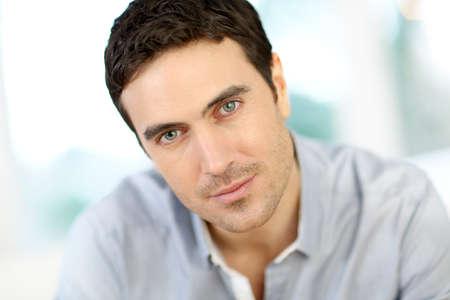 brown hair blue eyes: Portrait of handsome man with dark hair