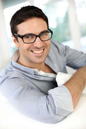 Handsome guy with eyeglasses on photo