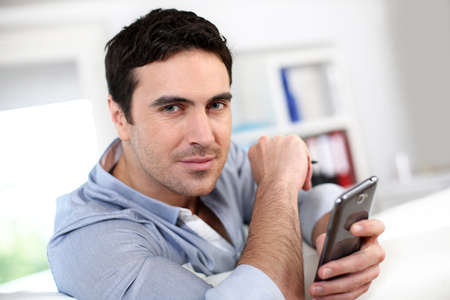 35 years old: Portrait of handsome man using martphone