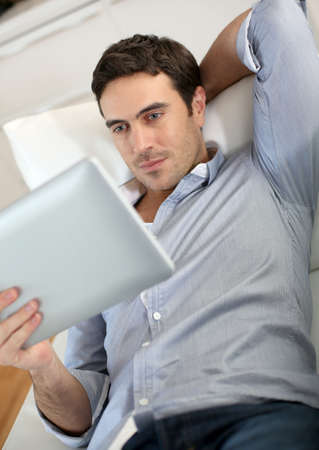 Man websurfing on internet with digital tablet photo