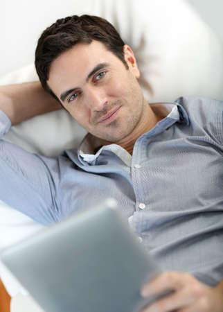 handsome old man: Man websurfing on internet with digital tablet