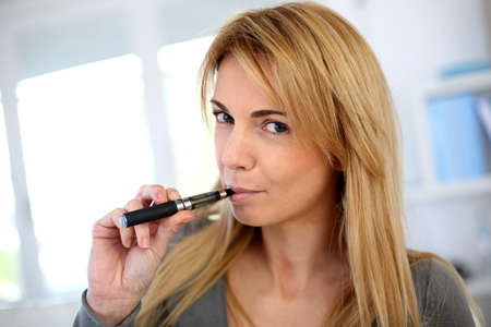 substitution: Woman smoking with electronic cigarette