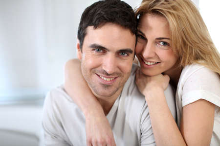 35 years old: Cheerful couple embracing each other