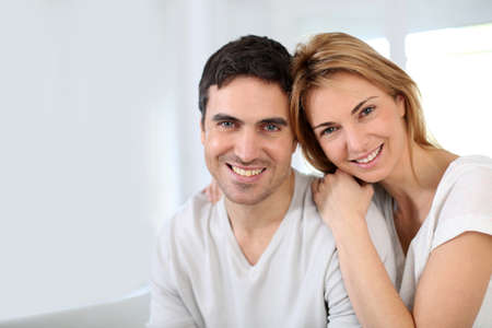 family sofa: Married couple relaxing at home Stock Photo