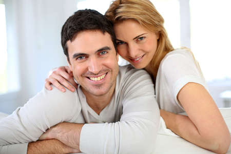 35 years old: Portrait of cheerful middle-aged couple Stock Photo