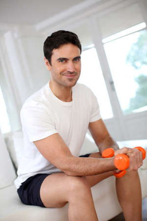 35 years old man: Man exercising with dumbbells in the morning Stock Photo