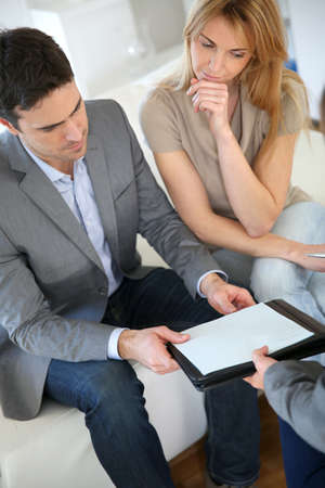 financial guidance: Couple meeting financial adviser for investment