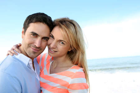 35 years old: Couple embracing each other by the sea