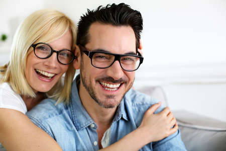 wearing glasses: Middle-aged couple wearing eyeglasses Stock Photo
