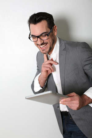 Cheerful salesman using digital tablet photo