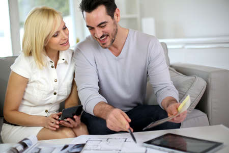 Couple looking at paint colors for new home Stock Photo - 18918496