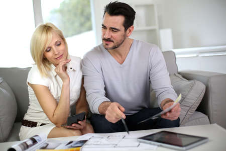 Couple looking at paint colors for new home Stock Photo - 18918494