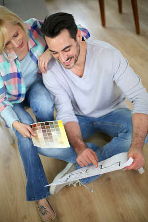 doityourself: Couple at home ready to remodel the rooms Stock Photo