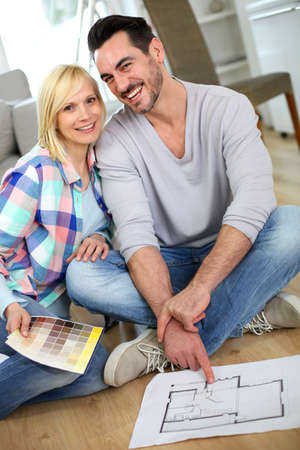 Couple at home ready to remodel the rooms photo