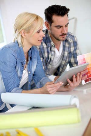 Middle-aged couple choosing wall colours for new home Stock Photo - 18918580