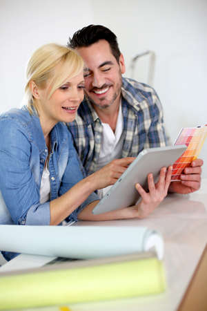 Middle-aged couple choosing wall colours for new home Stock Photo - 18918577