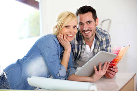 Middle-aged couple choosing wall colours for new home Stock Photo - 18918575